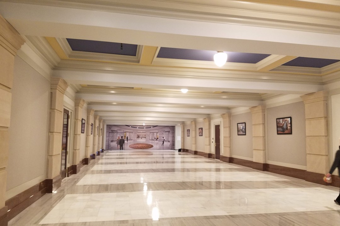 Wide hall of the OK Capitol with several pictures framed by Wyman Frame.