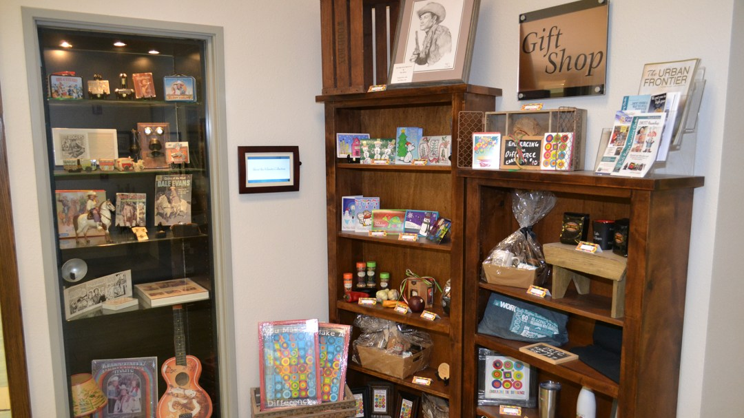 Two shelves display items for sale in Robin's Corner Gift Shop at Dale Rogers Training Center.