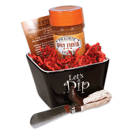 Spicy Fiesta dip set in a bowl, with a dip spreader.