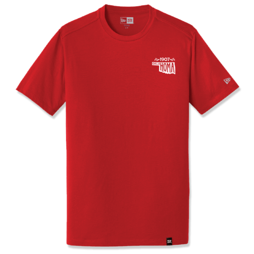 "Scarlet colored shirt featruing a graphic in the left front pocket area that shows ""1907"" and the state shape of Oklahoma, with the state's name written inside it. New Era logo is visible on the left sleeve; New Era tag is on the bottom front of shirt."