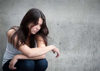 A young woman looking depressed.
