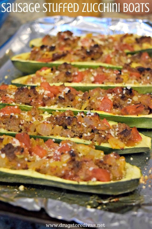 Dinner Sausage Stuffed Zucchini Boats are stuffed with sausage, tomatoes, onions, and more. They're good for keto and WW too.