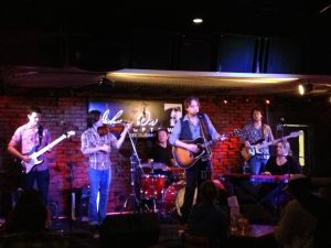 Hayes Carll fronts the Warren Hood Band at Johnny D's on June 11