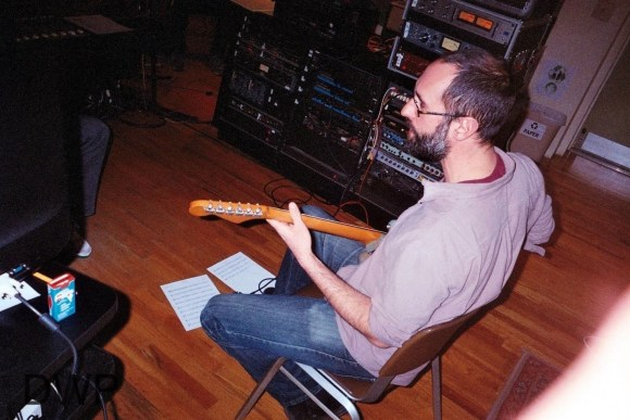 Steve Fell laying down guitars