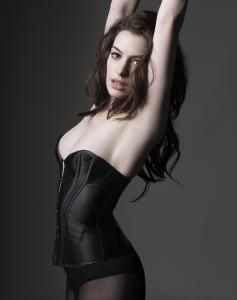 catwoman anne hathaway stretches and her boobs almost fall out.jpg