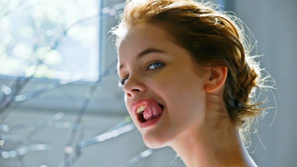 Barbara Palvin licking her snaggle tooth