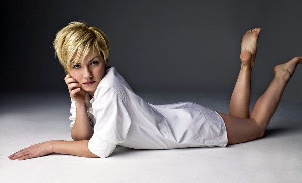 Elisha Cuthbert in a white top with her feet out