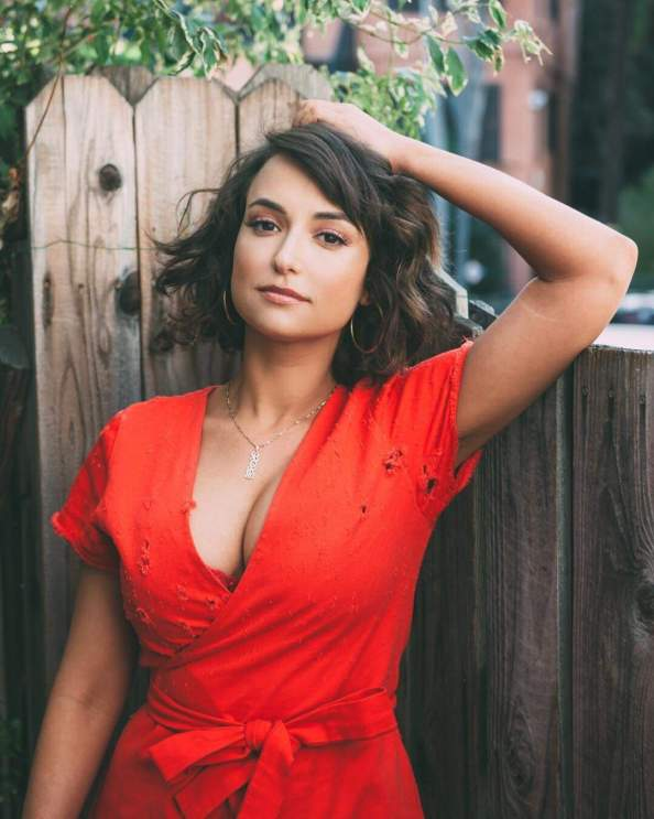 Milana Vayntrub in a red top