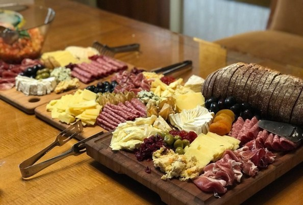 A board of meat and cheese A board of meat and cheese
