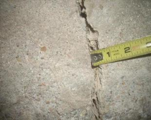 Crack in foundation with tape measure