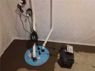 Sump pump and backup battery installed in basement