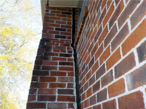 Chimney separating from brick house