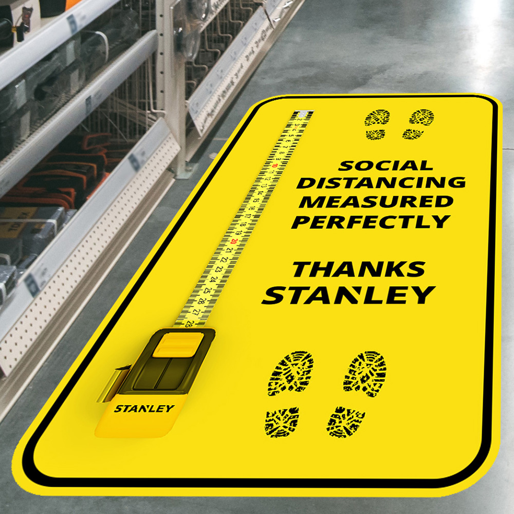 The future of floor graphics with Drytac; tape measure showing social distancing while still remaining true to its brand.