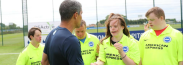 Chris Hughton, manager of Brighton & Hove Albion football club meets players at the Albion Community Trust's football tournament for players with Down's syndrome