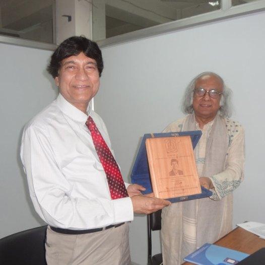 Prof. Haider A. Khan receiving an award from Dr. Qazi Kholiquzzaman Ahmad