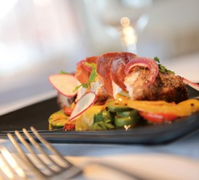 Berkwood Farms pork is served with green olives and braised vegetables.