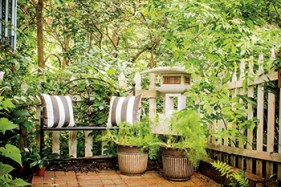 """A garden created for reflection and meditation typically offers ample opportunities to sit. Perea prefers two seats, inviting clients and friends to join her in the garden for conversation and spiritual direction. A bowl of water for soothing sound never hurts, either. """"Whatever your beliefs or style, a crucial element is to set aside a space for you to reconnect with yourself,"""" Perea says. """"That's the essence of a contemplative garden."""""""