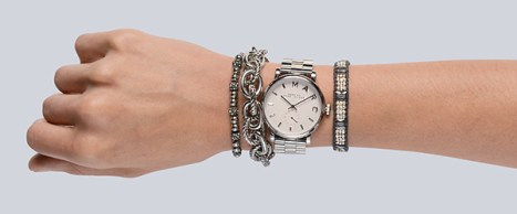 Michael Kors silver bead bracelet ($85 at Von Maur). Shiny and matte-finished silver chain-link bracelet ($21 at Dornink). Marc by Marc Jacobs silver tone watch with white dial ($175 at Von Maur). Chan Luu gray and silver seed bead-woven bracelet ($170 at Von Maur).