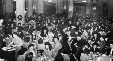 Younkers employees fill the famous Tea Room and adjacent dining rooms for a company Christmas party in 1945.
