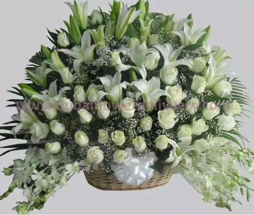 white lilies roses orchids big basket
