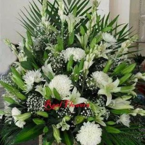 Surprise with white flowers basket in Dubai