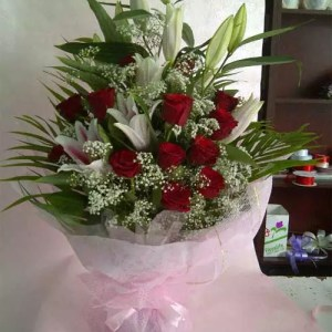 Care Catelyst Bouquet of lilies roses