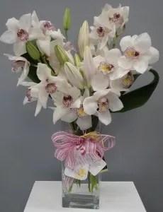 cymbidium orchids lilies vase