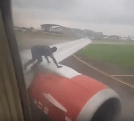 Nigerian intruder left wing airplane
