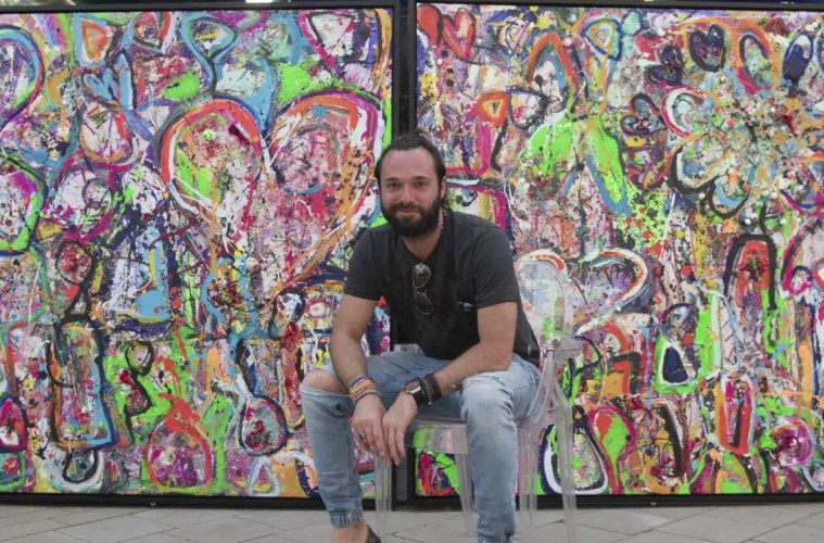 Sacha Jafri creates world's largest canvas painting for charity in Dubai