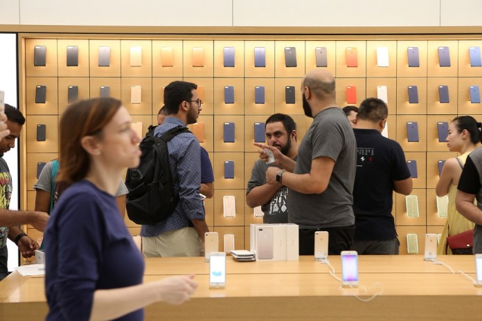 Customers shop at the Apple store in Dubai during the launch of the iPhone 7 at Mall of the Emirates. Pawan Singh / The National
