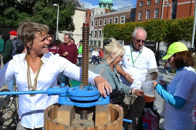Lord Mayor Aine Clancy at the Harvest Festival using an apple press