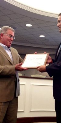Commissioner Robley presented the INSHARP designation award to Cale Knies.