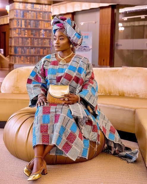 A Nigerian woman wearing Aso-oke