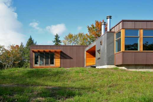 A Vermont prefab residence illustrates sustainable living via materials and design.