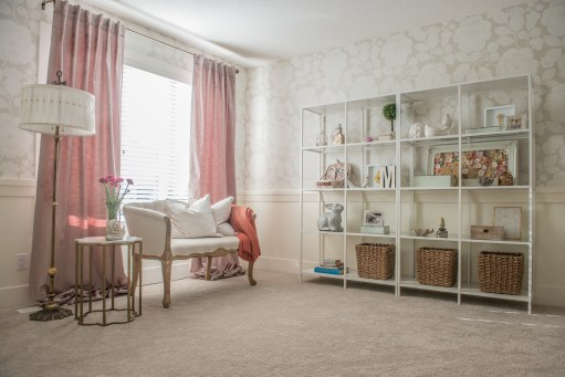 An appreciation of color, fabrics and an edited display soften a room.