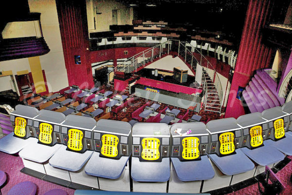 The unusual arrangement on the stage as viewed from the balcony. Note the later colour scheme of red rather than the blue of 1995. © Mikey Jones.
