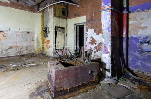 Part of the basement room, with the dumb waiter (which served all floors) in the back corner. © Scrappy nw.