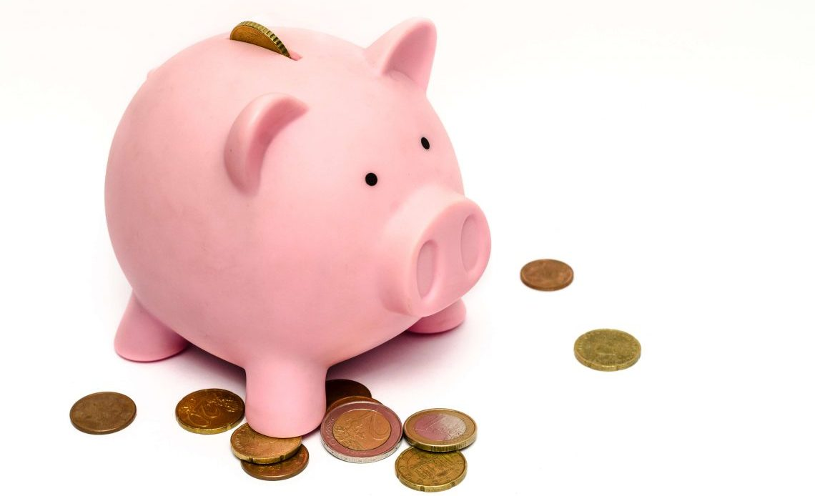 What Millennials Need to Know About Saving and Money Management - Pink Piggy Bank With Coins