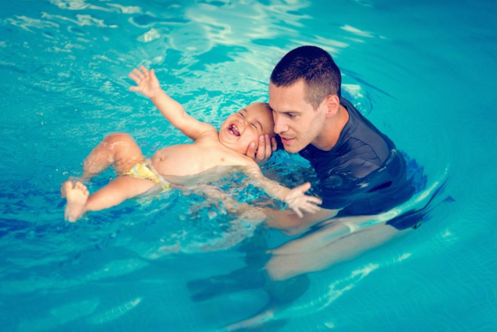 Man With Baby Swimming