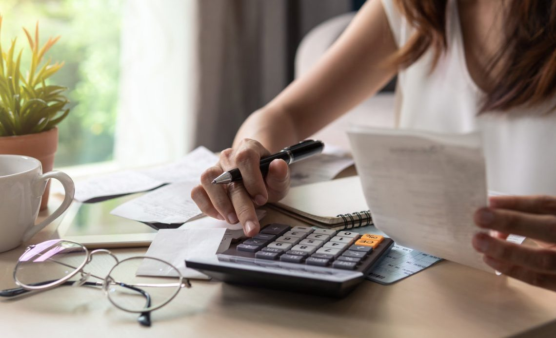 Women With Calculator Budgeting