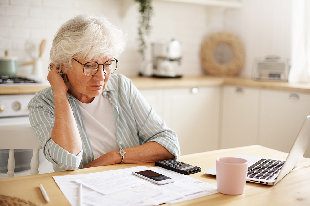 Elderly Women Calculating National Insurance