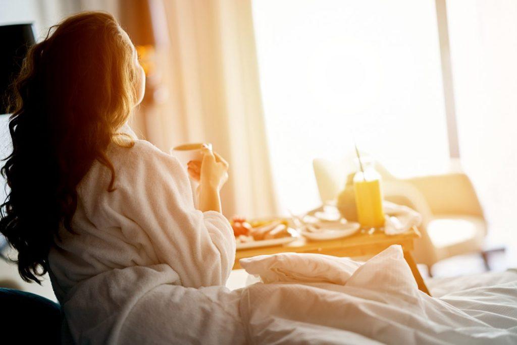 Breakfast in bed, cozy hotel room