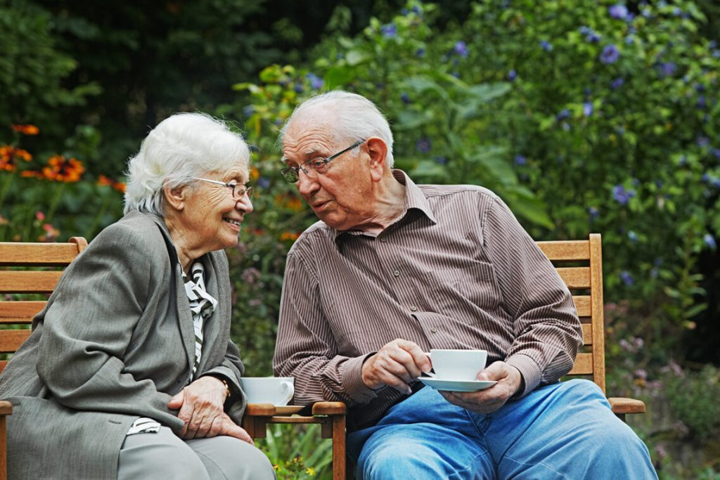 Elderly couple on the garden bench