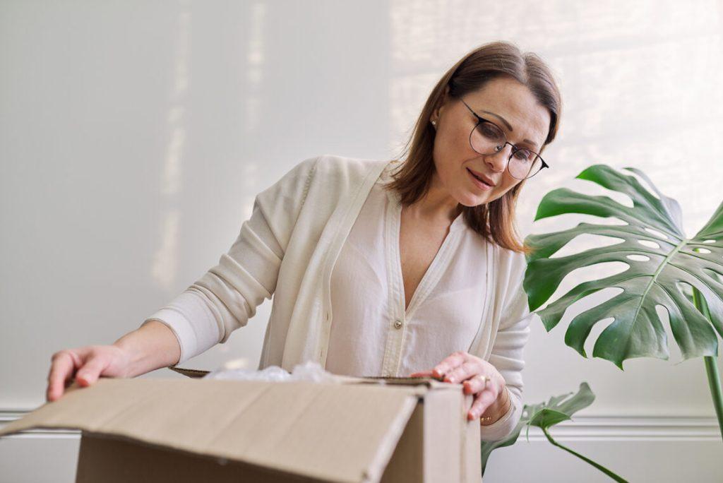 Women unpacking parcel delivery