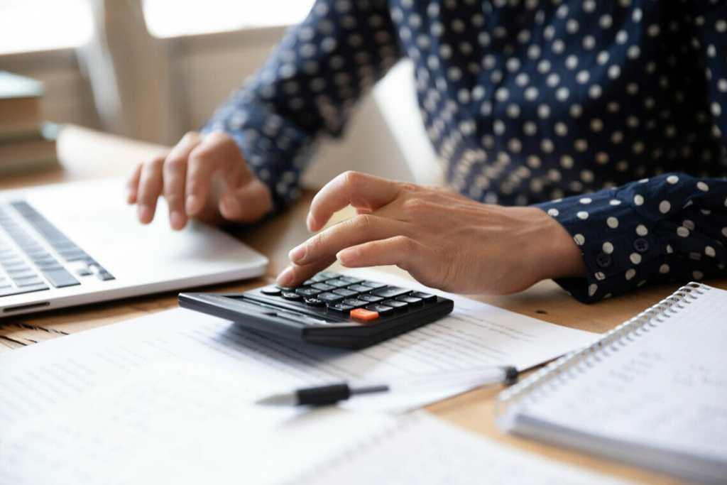 Women using calculator for business