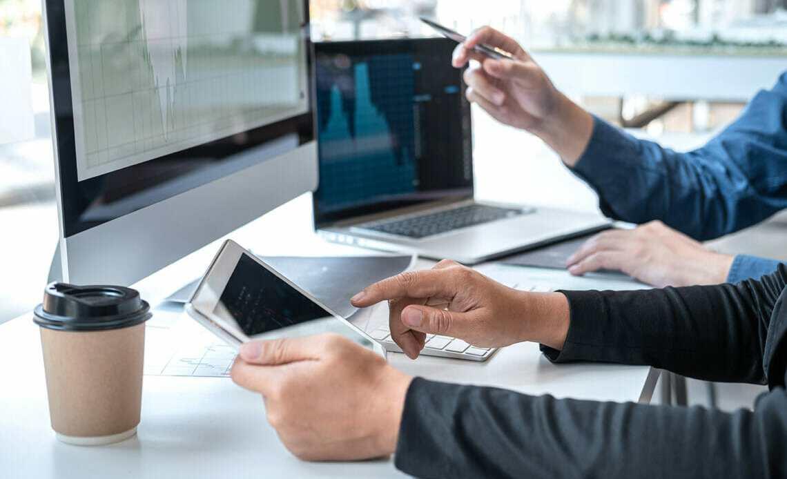 Laptop, desktop and notepad