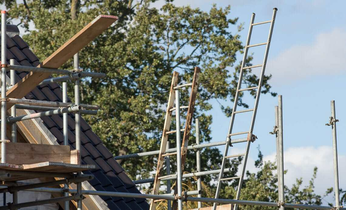 Roof of house with scaffolding