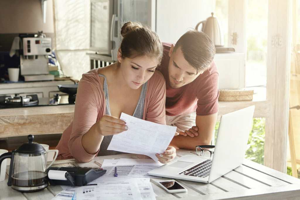 Couple sorting out bills and finances