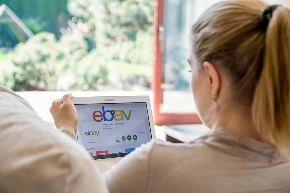 Younge women on tablet using eBay