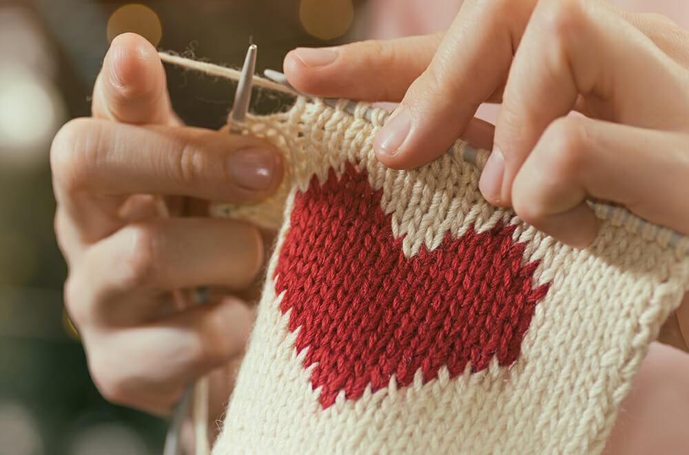 Homemade present. Knitting heart design